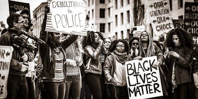 Black Lives Matter protesters with signs and microphone